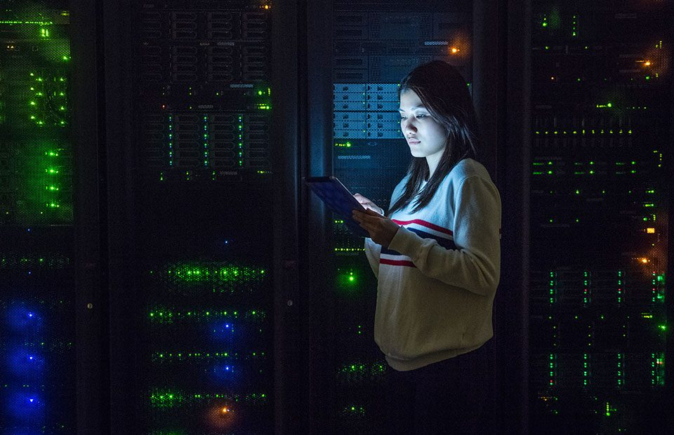Young-woman-working-on-digital-tablet-in-server-room_960x620